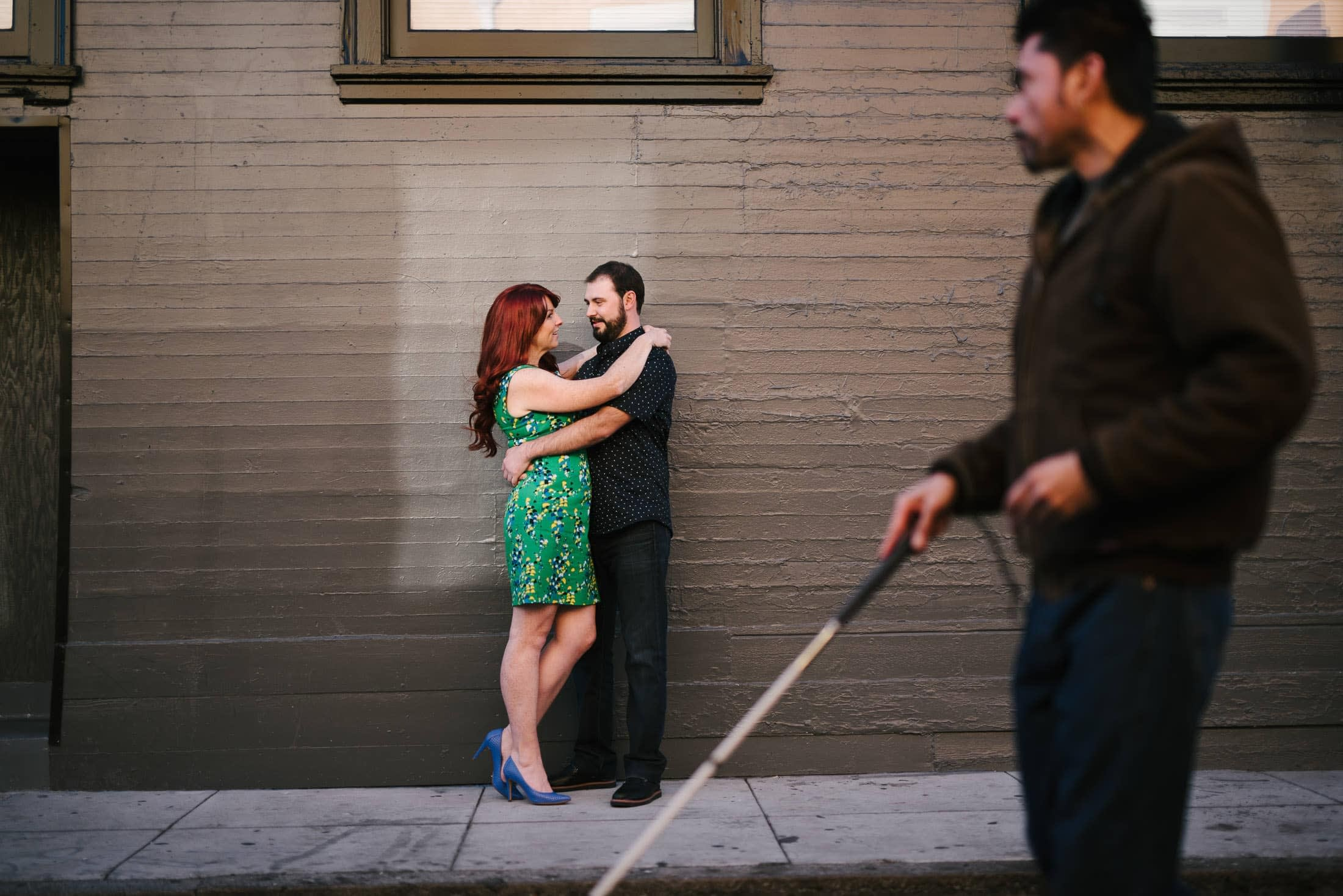 San Francisco Engagement Shoot with Blind man walking in front of couple